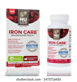 Winneconne, WI - 4 August 2019 : A bottle of Nu Life therapeutics iron care build blood cells on an isolated background
