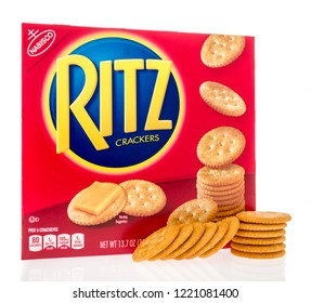 Winneconne, WI - 4 November 2018: A box of Ritz crackers with Ritz crackers next to the box on an isolated background.