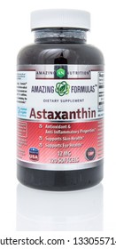 Winneconne, WI - 5 March 2019: A bottle of Amazing Nutrition astaxanthin supplement on an isolated background