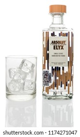 Winneconne, WI - 7 September 2018: A bottle of Absolut ELYX single estate handcrafted vodka from Sweden with a glass of ice on an isolated background