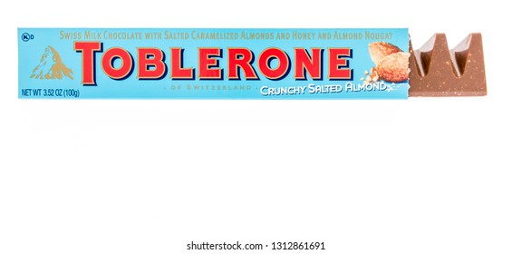 Winneconne, WI - 8 February 2019: A package of Toblerone swiss milk chocolate crunchy salted almond candy bar on an isolated background