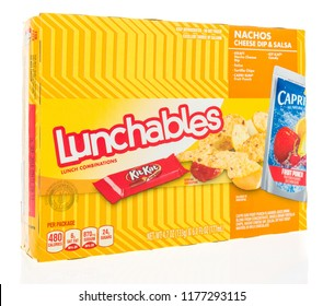 Winneconne, WI - 9 September 2018: A package of Lunchables with Kraft cheese, Capri Sun drink and a KitKat candy bar on an isolated background
