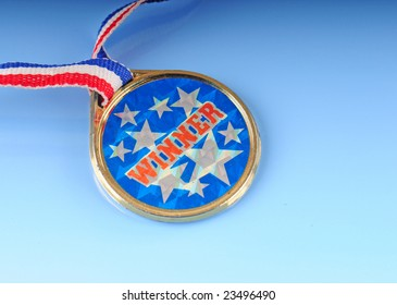 Winner medallion on colorful string