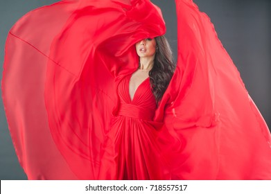 The winner of the Miss contest in red dress