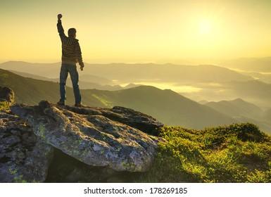 Winner on mountain peak. Active life concept