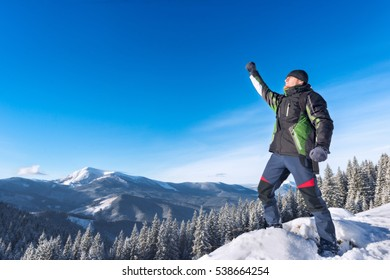 The winner stands in the snowy mountains of the Carpathian Mountains, the ridge Chornohora, Ukraine, Europe, success, good day, champion in the highest, achieving goals