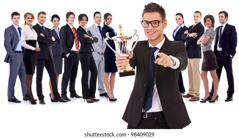 winning business team with  leader holding a big trophy cup and pointing to you, on white background