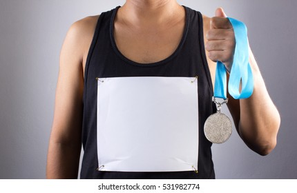 Winning at the games, Hand holding winner medal, Success Motivation