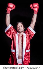 Winning male boxer celebrating with arms raised