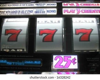 winning red sevens on a casino slot machine