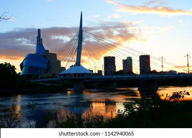 Winnipeg bridge and human right canadian museum in dusk and stunning red river reflection. Manitoba Canada. June 29th 2017.