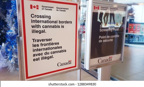 WINNIPEG, CANADA - JANUARY, 2019: Cannabis warning signs at the security checks in Winnipeg Airport.