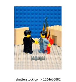 """Winnipeg, Manitoba / Canada - August 2012: Two LEGO minifigures recreate Pink Floyd's """"Wish You Were Here"""" album cover where two men shake hands while the other one is on fire"""