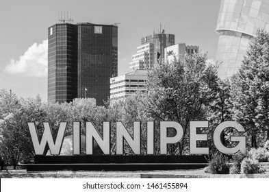 Winnipeg, Manitoba / Canada - July 13 2019: Winnipeg Sign with Downtown Skyline in the Background