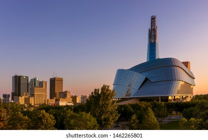 Winnipeg, Manitoba, Canada - July 16, 2019: The Canadian Museum of Human Rights and downtown Winnipeg during sunrise