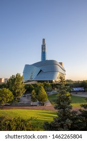 Winnipeg, Manitoba, Canada - July 16, 2019: The Canadian Museum of Human Rights and the Winnipeg sign in the Forks