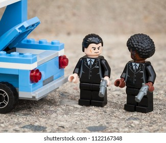 "Winnipeg, Manitoba, Canada - March 2012: LEGO Vincent Vega and LEGO Jules Winnfield are thinking that ""they should have shotguns for this type of deal."" (from ""Pulp Fiction"")"