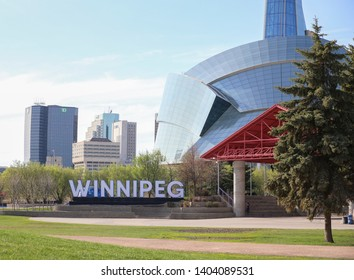 Winnipeg, Manitoba / Canada - May 21, 2019: View of the Canadian Museum for Human Rights and Winnipeg Cityscape.
