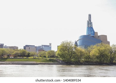 Winnipeg, Manitoba / Canada - May 21, 2019: View of the Red River and the Canadian Museum for Human Rights. Winnipeg Cityscape.