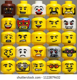 Winnipeg, Manitoba, Canada - October 2011: Different LEGO minifigure heads stacked side-by-side and one on top of each other. This shows the evolution of LEGO minifigure head prints through the years.