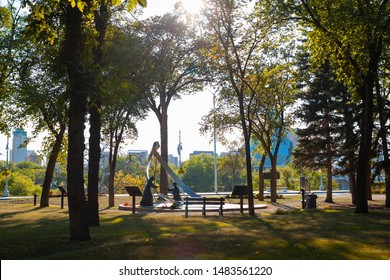 Winnipeg, Manitoba/Canada - August 2019: The St. Boniface Heritage Garden on a late sunny afternoon, with the Canadian Museum for Human Rights peeking in the background