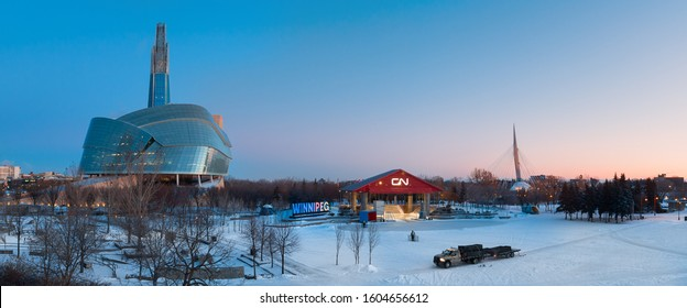 Winnipeg, Manitoba/Canada - December 2019: Panoramic view of the Forks, with the Canadian Museum for Human Rights, the CN stage, and Esplanade Riel seen during sunrise in winter