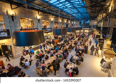 Winnipeg, Manitoba/Canada - February 2018: People dining inside the Forks Market food hall