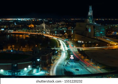 Winnipeg, Manitoba/Canada - October 2019: Aerial view of Winnipeg at night, with light streaks of vehicles moving through the streets