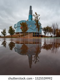 Winnipeg, Manitoba/Canada - October 2019: The Canadian Museum for Human Rights reflected on a water puddle on a cloudy day