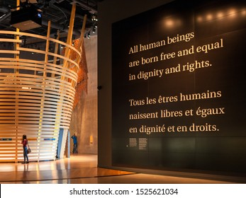 Winnipeg, Manitoba/Canada - October 2019: People taking photos of exhibits inside the Canadian Museum for Human Rights