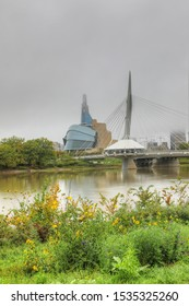 WINNIPEG, MANITOBA/CANADA- SEPTEMBER 26, 2019: A Vertical of Museum for Human Rights and Bridge in fog in Winnipeg