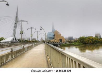 WINNIPEG, MANITOBA/CANADA- SEPTEMBER 26, 2019: The Bridge and Museum for Human Rights in mist in Winnipeg, Manitoba