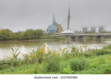 WINNIPEG, MANITOBA/CANADA- SEPTEMBER 26, 2019: The Museum for Human Rights and Bridge in fog in Winnipeg