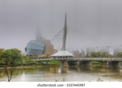 WINNIPEG, MANITOBA/CANADA- SEPTEMBER 26, 2019: The Bridge and Museum for Human Rights in mist in Winnipeg