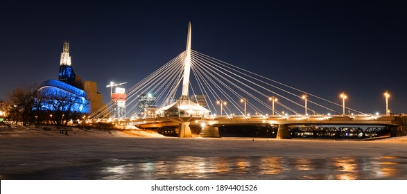 Winnipeg, MB, Canada - January 2021: The Canadian Museum for Human Rights and the Esplanade Riel viewed from a frozen Red River at night