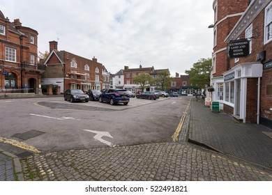 Winslow, Buckinghamshire, United Kingdom, October 25, 2016: Market Square with parked cars on grey chilly morning.