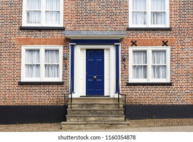 Winslow, UK - April 27, 2015. Front door of a traditional historic brick house in the UK