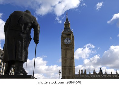 Winston Churchill statue looking at the Tower Clock of Westminster Palace, Parliament Square, London, UK.