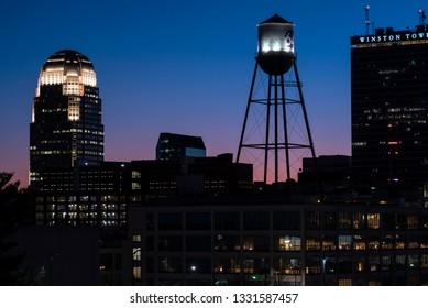 Winston Salem, NC/United States- 03/05/2019: Silhouette of the Winston Salem skyline against a colorful night sky.