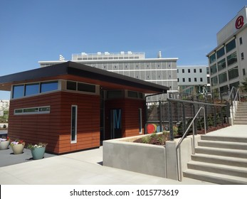 WINSTON-SALEM, NC / USA - APRIL 2015: Bailey Park Shelter with the Wake Forest Innovation Quarter in the Background