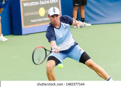 WINSTON-SALEM, NC, USA - AUGUST 17: Bjorn Fratangelo plays center court on August 17, 2019 at the Winston-Salem Open in Winston-Salem, North Carolina.