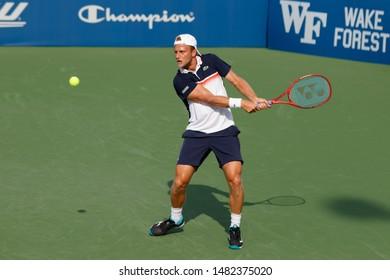 WINSTON-SALEM, NC, USA - AUGUST 18: Denis Kudla plays center court on August 18, 2019 at the Winston-Salem Open in Winston-Salem, North Carolina.