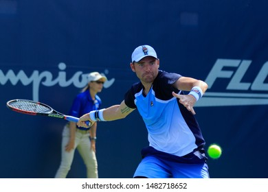 WINSTON-SALEM, NC, USA - AUGUST 18: Bjorn Fratangelo plays center court on August 18, 2019 at the Winston-Salem Open in Winston-Salem, North Carolina.
