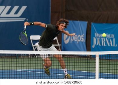WINSTON-SALEM, NC, USA - AUGUST 18: Lloyd Harris plays during first round on August 18, 2019 at the Winston-Salem Open in Winston-Salem, North Carolina.