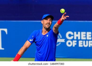 WINSTON-SALEM, NC, USA - AUGUST 21: Steve Johnson plays center court on August 21, 2019 at the Winston-Salem Open in Winston-Salem, North Carolina.