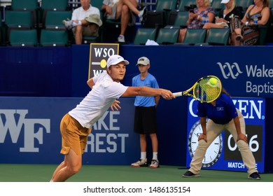 WINSTON-SALEM, NC, USA - AUGUST 21: Miomir Kecmanovic plays center court on August 21, 2019 at the Winston-Salem Open in Winston-Salem, North Carolina.