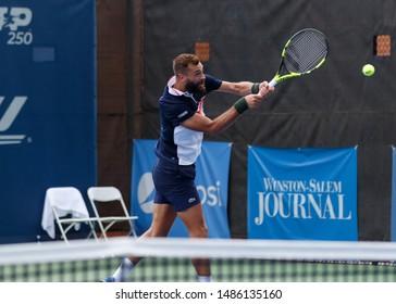 WINSTON-SALEM, NC, USA - AUGUST 21: Benoit Paire playsii on August 21, 2019 at the Winston-Salem Open in Winston-Salem, North Carolina.
