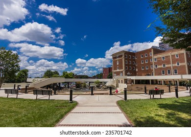 WINSTON-SALEM, NC, USA - JULY 15:Workers taking a lunch break at Winston Square Park on July 15, 2013 in Winston-Salem, NC, USA