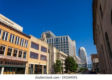 WINSTON-SALEM, NC, USA JUNE 3: Winston-Salem Downtown from Liberty Street on June 3, 2013 in Winston-Salem, NC. Including R. J. Reynolds, Winston Tower, One West Fourth Street and Wells Fargo Center.