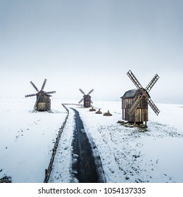 Winter aerial drone landscape with snow old wooden rustic windmills
